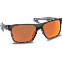 Okulary przeciwsłoneczne OAKLEY - Crossrange OO9361-1257 Grey Smoke/Prizm Ruby. Brązowe okulary przeciwsłoneczne męskie aviatory Oakley, z tworzywa sztucznego. W wyprzedaży za 579,00 zł.
