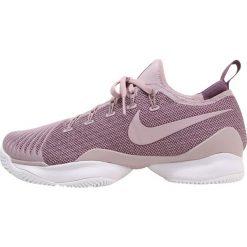 Nike Performance AIR ZOOM ULTRA REACT HC Obuwie multicourt elemental rose/pro purple/white. Czerwone buty sportowe damskie marki Nike Performance, z materiału, na golfa. W wyprzedaży za 440,30 zł.