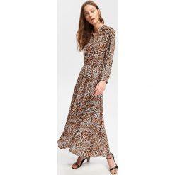 Sukienka z motywem zwierzęcym - Wielobarwn. Szare sukienki z falbanami marki Reserved, l, z motywem zwierzęcym. Za 159,99 zł.