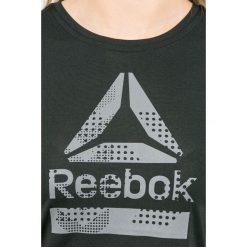 Reebok - Top. Szare topy damskie marki Reebok, l, z nadrukiem, z elastanu, z krótkim rękawem. W wyprzedaży za 129,90 zł.