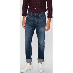 Tommy Jeans - Jeansy. Niebieskie jeansy męskie z dziurami marki Tommy Jeans. Za 399,90 zł.