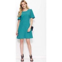 Zielona Sukienka Trapezowa z Kloszowanym Rękawem. Czarne sukienki na komunię marki bonprix, do pracy, w paski, biznesowe, moda ciążowa. Za 119,90 zł.