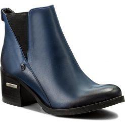 Botki CARINII - B3705  G86-000-PSK-861. Niebieskie buty zimowe damskie Carinii, z materiału, na obcasie. W wyprzedaży za 199,00 zł.