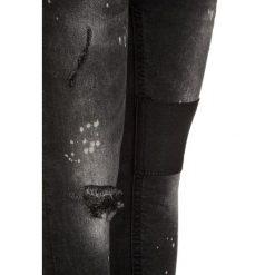 Next PAINT SPLAT PATCH  Jeans Skinny Fit black. Czarne jeansy męskie relaxed fit Next. Za 129,00 zł.