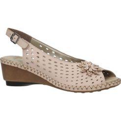 Różowe sandały skórzane ażurowe na koturnie Rieker 66177-31. Czarne sandały damskie marki Rieker, z materiału. Za 238,99 zł.