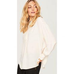 Koszula oversize - Kremowy. Białe koszule damskie marki Reserved. Za 119,99 zł.