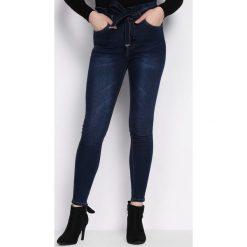 Niebieskie Jeansy Series. Czarne jeansy damskie marki Born2be, l. Za 89,99 zł.