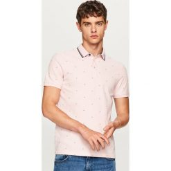 Koszulka polo w drobny wzór - Różowy. Fioletowe koszulki polo marki KIPSTA, m, z elastanu, z długim rękawem, na fitness i siłownię. Za 59,99 zł.