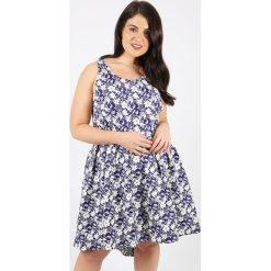 Sukienki hiszpanki: Półdługa, rozszerzana sukienka we wzór