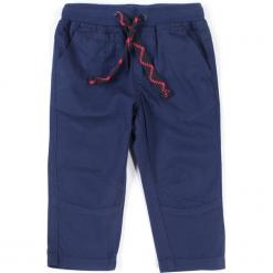 Spodnie. Niebieskie spodnie chłopięce MY DOG, z aplikacjami, z bawełny, długie. Za 59,90 zł.