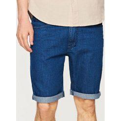 Jeansowe szorty SLIM FIT - Granatowy. Niebieskie bermudy męskie Reserved, z jeansu. W wyprzedaży za 29,99 zł.