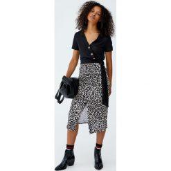 Spódniczki: Spódnica w panterkę z rozcięciem