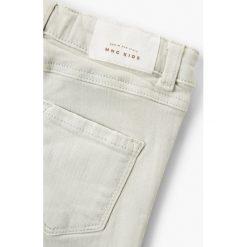 Spodnie damskie: Mango Kids – Jeansy dziecięce Patri 110-164 cm