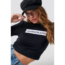 Calvin Klein Top Institutional Box Cropped Fit - Black. Czarne topy sportowe damskie Calvin Klein, z materiału. Za 242,95 zł.