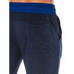 KRÓTKIE SPODENKI MĘSKIE DRESOWE W050 - GRANATOWE. Niebieskie spodenki dresowe męskie marki Ombre Clothing. Za 39,20 zł.