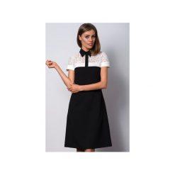 Elegancka wizytowa czarna sukienka z kołnierzykiem POLO II. Czarne sukienki marki Duhla agnieszka barańska, w koronkowe wzory, z koronki, eleganckie, polo, midi, sportowe. Za 360,00 zł.