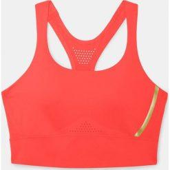 Biustonosze sportowe: Under Armour Biustonosz Breatehlux Perforated Mid czerwony r. S (1307229-985)
