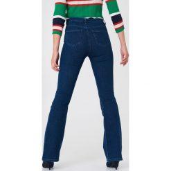 Trendyol Jeansy bootcut z suwakiem - Blue. Niebieskie jeansy damskie bootcut marki Trendyol, z podwyższonym stanem. W wyprzedaży za 97,17 zł.