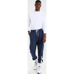 Spodnie męskie: Ellesse CESENA Spodnie treningowe dress blues