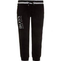 BOSS Kidswear Spodnie treningowe schwarz. Niebieskie jeansy chłopięce marki BOSS Kidswear. Za 269,00 zł.