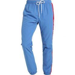 Spodnie dresowe męskie: YOURTURN Spodnie treningowe blue