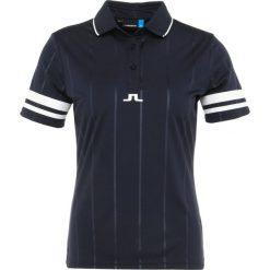 J.LINDEBERG FEBE  Koszulka polo navy. Niebieskie bluzki sportowe damskie J.LINDEBERG, xs, z materiału. Za 379,00 zł.