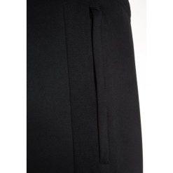 Nike Performance DRY PANT Spodnie treningowe black. Czarne spodnie chłopięce marki Nike Performance, z bawełny. Za 139,00 zł.