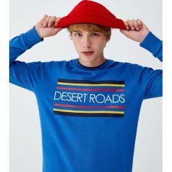 """Bluza z napisem """"Desert roads"""". Czarne bluzy męskie rozpinane marki Pull&Bear, m. Za 62,90 zł."""