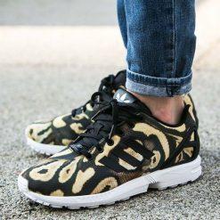 Buty adidas ZX Flux Women (S77310). Białe buty sportowe damskie adidas zx flux marki Adidas, z materiału. Za 119,99 zł.