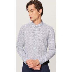 Wzorzysta koszula slim fit - Niebieski. Niebieskie koszule męskie slim marki QUECHUA, m, z elastanu. Za 99,99 zł.