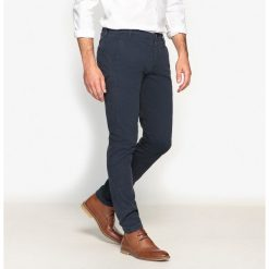 Spodnie typu chino, krój slim. Szare chinosy męskie Selected, z bawełny. Za 267,71 zł.