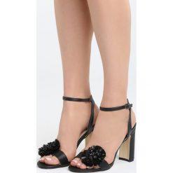 Czarne Sandały Be Unique. Czarne sandały damskie na słupku marki Born2be, z materiału, na wysokim obcasie. Za 79,99 zł.