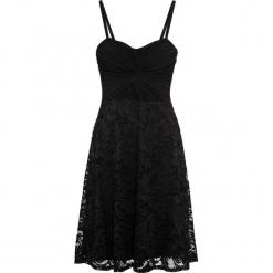 Sukienka z siatkową wstawką i koronką bonprix czarny. Czarne sukienki koronkowe marki bonprix, w koronkowe wzory, z kopertowym dekoltem, kopertowe. Za 109,99 zł.