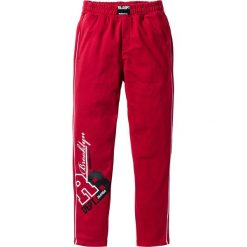 Spodnie dresowe męskie: Spodnie dresowe bonprix ciemnoczerwony