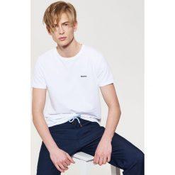 Spodnie męskie: Materiałowe joggery z kontrastowym wiązaniem - Granatowy