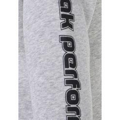 Peak Performance Bluza rozpinana medium grey melange. Szare bluzy dziewczęce Peak Performance, z bawełny. Za 319,00 zł.