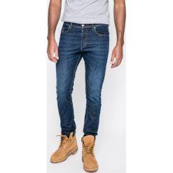 Diesel - Jeansy Tepphar. Niebieskie jeansy męskie slim marki Diesel, z bawełny. W wyprzedaży za 539,90 zł.