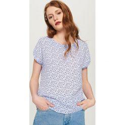 T-shirt we wzory - Niebieski. Niebieskie t-shirty męskie marki Reserved, l. W wyprzedaży za 24,99 zł.