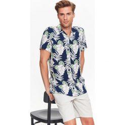 KOSZULA KRÓTKI RĘKAW MĘSKA. Brązowe koszule męskie marki QUECHUA, m, z elastanu, z krótkim rękawem. Za 39,99 zł.