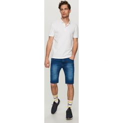 Jeansowe szorty SLIM FIT - Granatowy. Niebieskie spodenki jeansowe męskie marki QUECHUA, m. W wyprzedaży za 29,99 zł.