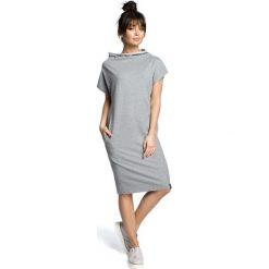 ALLISON Sukienka klepsydra - szary melanż. Białe sukienki dzianinowe marki BIALCON, na imprezę, w koronkowe wzory, z kopertowym dekoltem, midi, kopertowe. Za 136,99 zł.