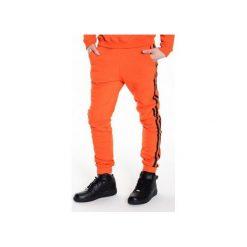 Spodnie dresowe z lampasami z eko-skóry |POMARAŃCZOWE| SS2015. Brązowe spodnie dresowe męskie MALE-ME, na lato, z nadrukiem, z bawełny. Za 220,00 zł.