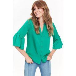 KOSZULA DAMSKA DŁUGI RĘKAW Z FALBANĄ. Szare koszule damskie Top Secret, na jesień, eleganckie, z koszulowym kołnierzykiem, z długim rękawem. Za 39,99 zł.