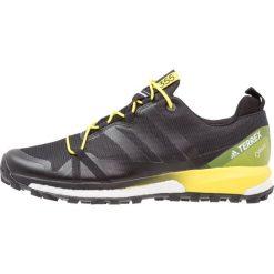 Adidas Performance TERREX AGRAVIC GTX Obuwie hikingowe dark grey/core black/bright yellow. Czarne buty sportowe męskie adidas Performance, z materiału, outdoorowe. W wyprzedaży za 519,20 zł.