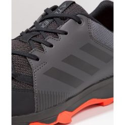Adidas Performance TERREX TRACEROCKER Obuwie hikingowe utility black/core black/energy. Czarne buty sportowe męskie adidas Performance, z materiału, outdoorowe. W wyprzedaży za 189,50 zł.