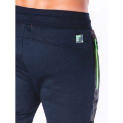 SPODNIE MĘSKIE DRESOWE P657 - GRANATOWE. Czarne spodnie dresowe męskie marki Ombre Clothing, m, z bawełny, z kapturem. Za 69,00 zł.