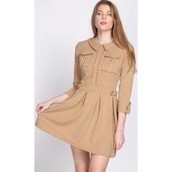 Beżowa Sukienka Restrict. Brązowe sukienki mini marki Born2be, uniwersalny. Za 89,99 zł.