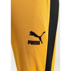 Spodnie dresowe męskie: Puma VINTAGE TRACK PANTS Spodnie treningowe mineral yellow/black