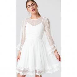 Trendyol Koronkowa sukienka z szerokim rękawem - White. Szare sukienki koronkowe marki Trendyol, na co dzień, casualowe, midi, dopasowane. Za 242,95 zł.