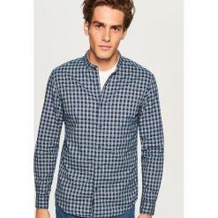 Koszula slim fit z bawełny organicznej - Granatowy. Niebieskie koszule męskie slim Reserved, l, z bawełny. Za 99,99 zł.